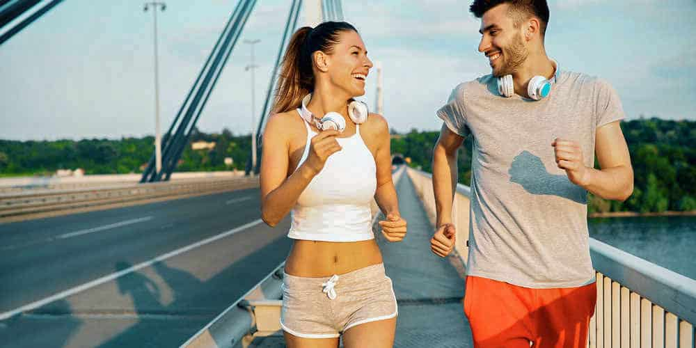 Cardio Workout at Home - Couple jogging and running outdoors in nature