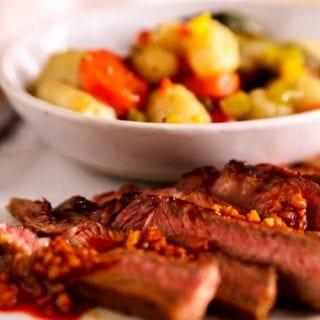 steak with primavera gnnochi