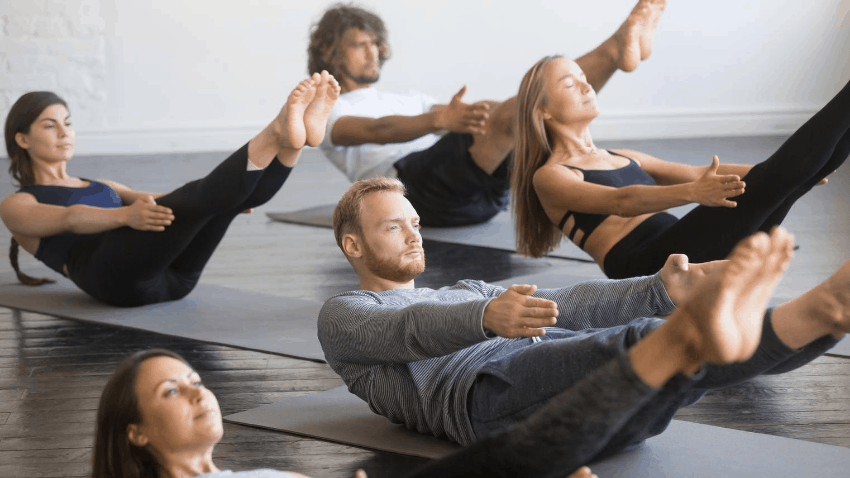 Pilates class of people